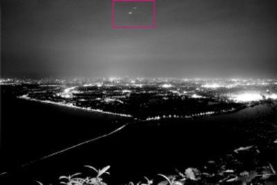 Bức ảnh có hai UFO của Dong Rong. Ảnh: People Daily.