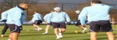 Beckham tươi vui trên sân tập của Tottenham