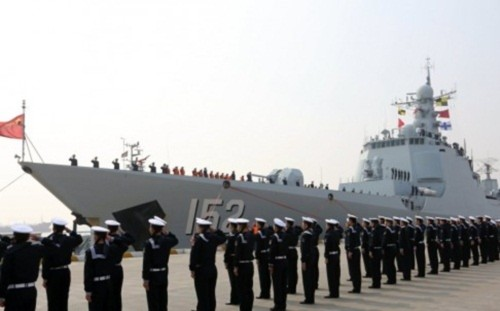 Chinese sailors salute as the destroyer Jinan returns to a military port in Zhoushan, in Zhejiang province in February. President Xi Jinping announced cuts of 300,000 military personnel by 2017. Photo: Xinhua